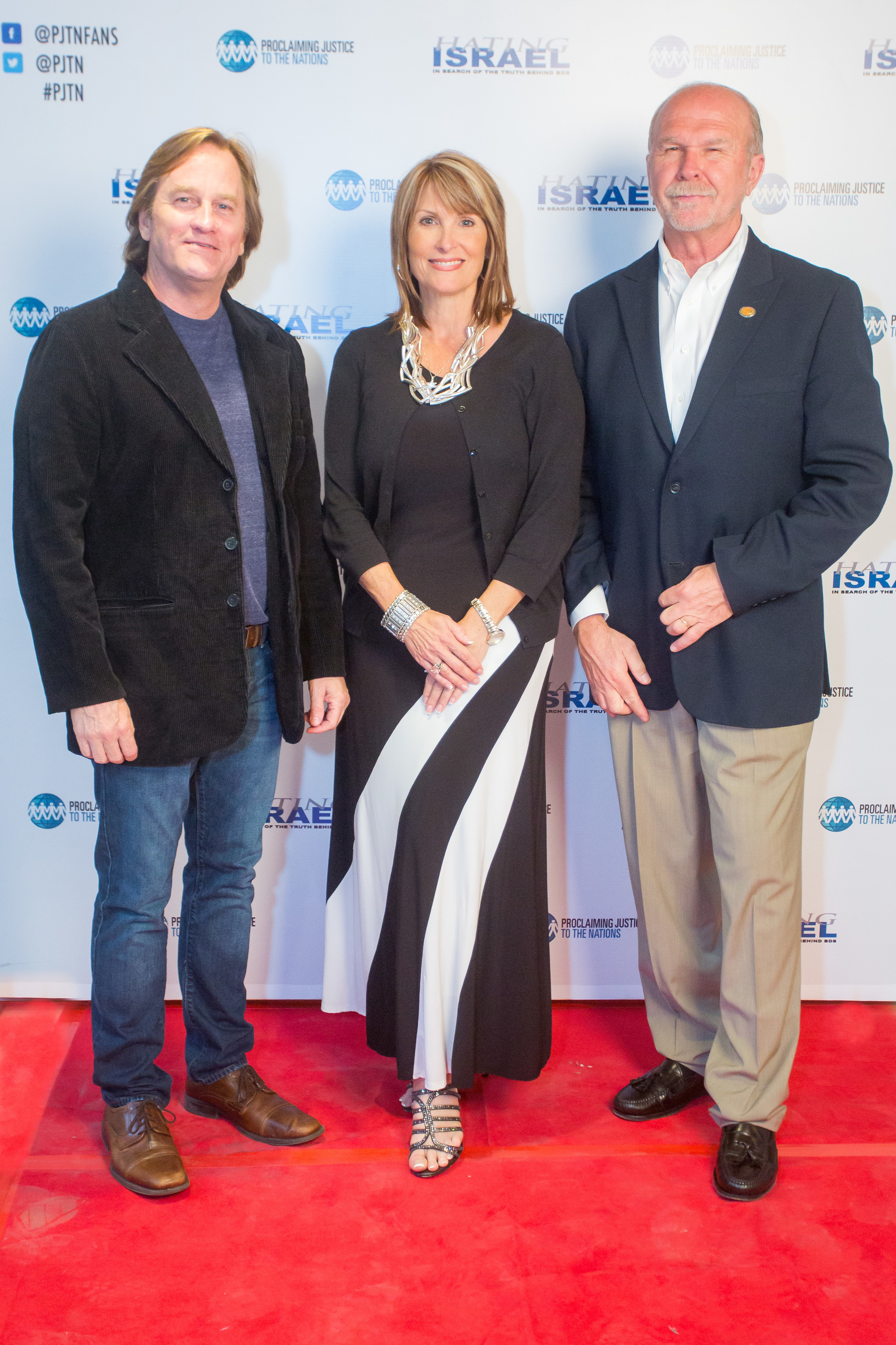 "Click photo to download. Caption: From left to right, comedian Brad Stine, producer Laurie Cardoza-Moore, and director Stan Moore at the June 8 Jerusalem premiere of the film ""Hating Israel: In Search of the Truth Behind BDS."" Credit: Aharon Hyman Photography."