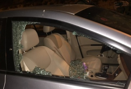 A vehicle whose windows were smashed by terrorists in Tuesday's overnight terror attack on Route 443 between Tel Aviv and Jerusalem. Credit: IDF Spokesperson's Unit.