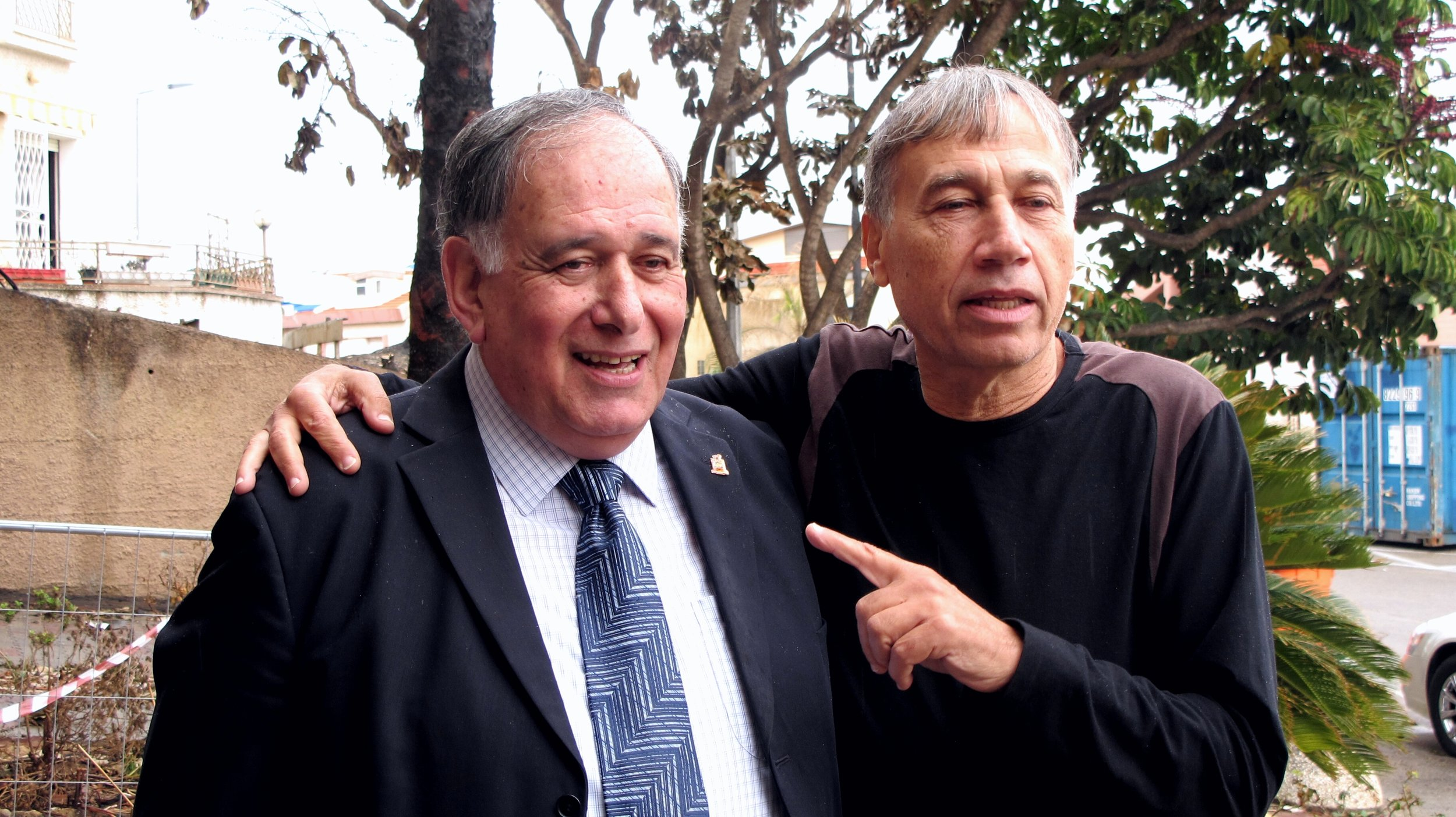 """Haifa Mayor Yona Yahav (left) with one of the city's residents, Meir Barzilay. """"The municipality is doing a great job to help us...We are grateful for the rapid support,"""" Barzilay says in the aftermath of the fires that recently ravaged Haifa. Credit: Franziska Knupper."""