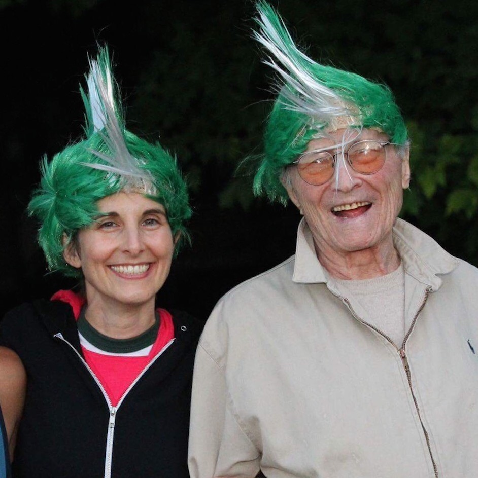 Liz Stevens and Larry Stevens, pictured here donning quirky wigs, have created a father-daughter legacy of camp leadership. Credit: Courtesy of Liz Stevens.