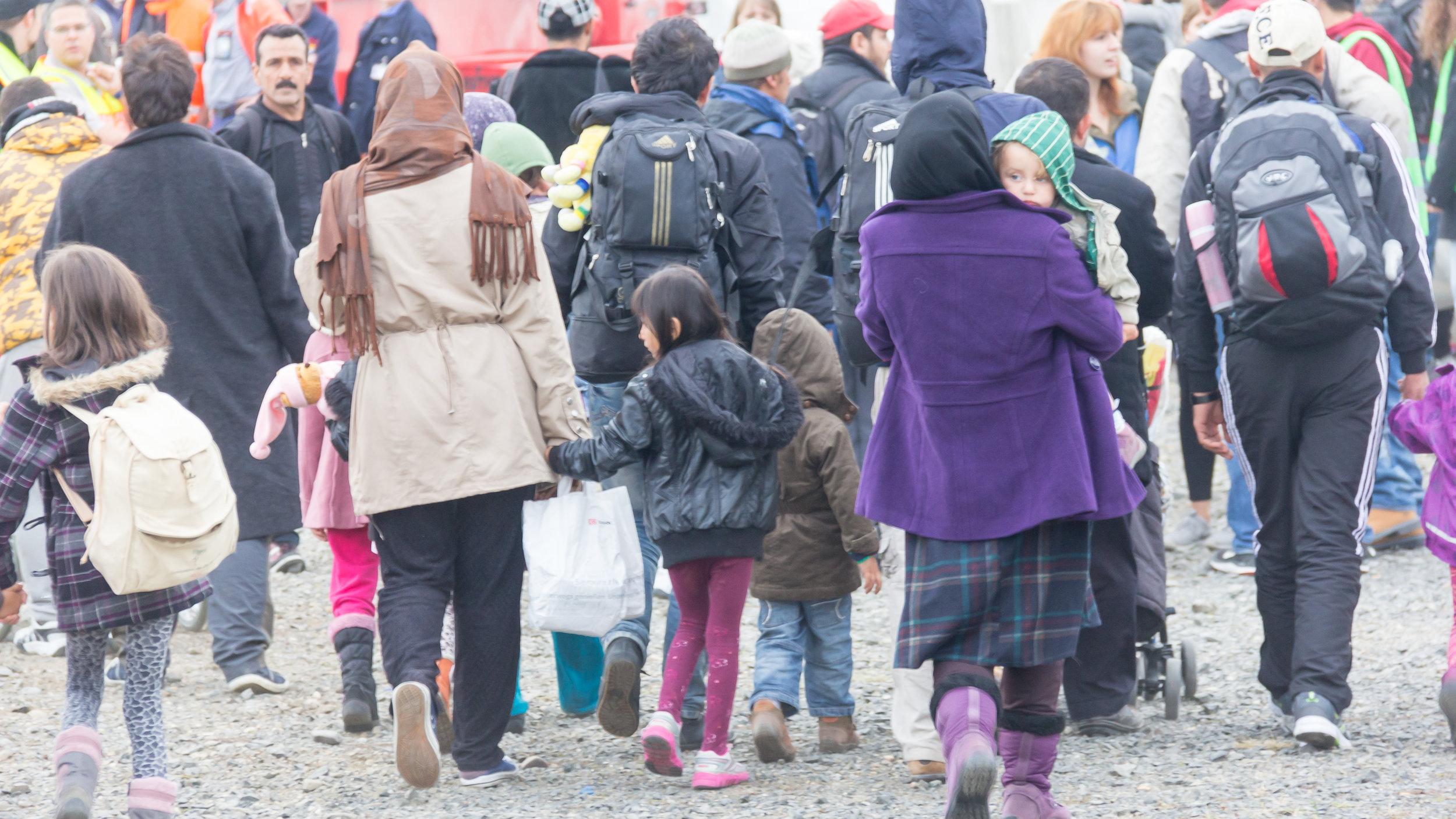 Mideast migrants arrive in Germany in October 2015. Credit: Raimond Spekking via Wikimedia Commons.