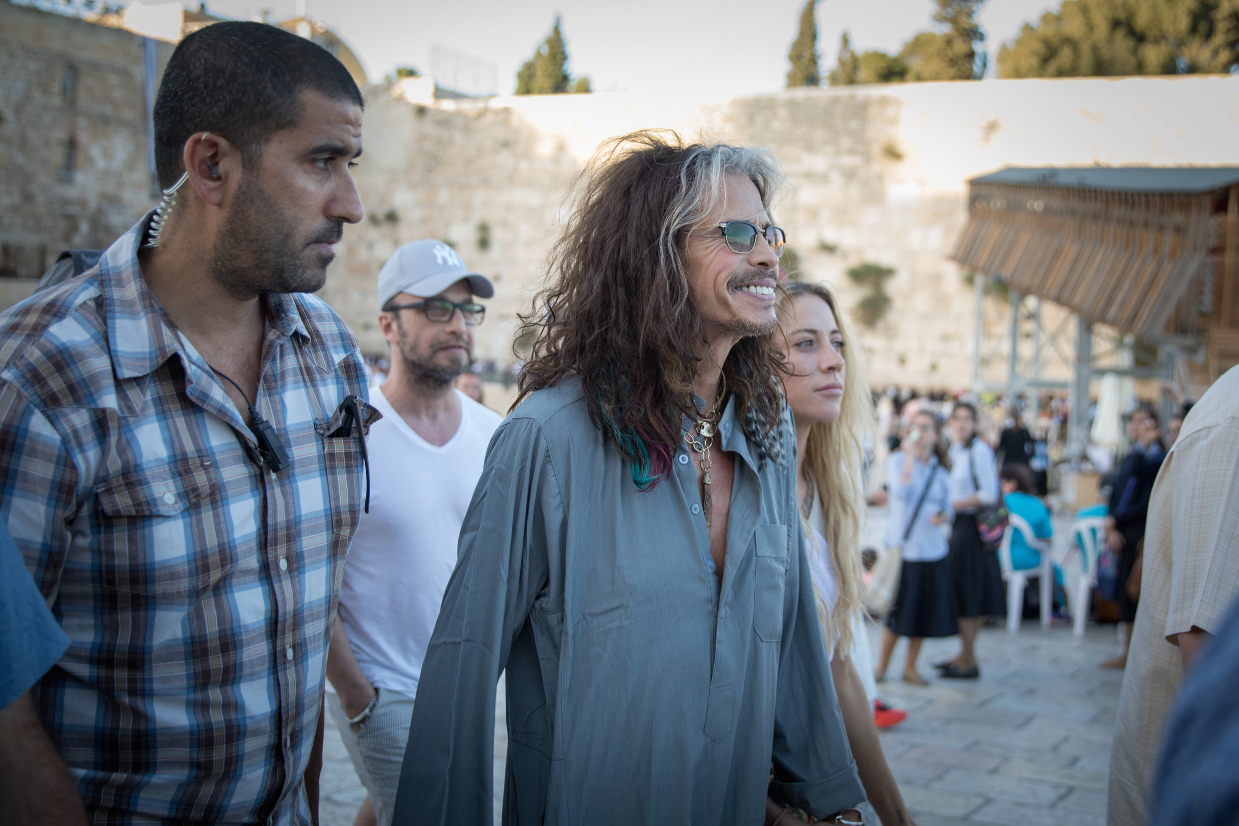 Aerosmith lead singer Steven Tyler (center) visits the Western Wall in Jerusalem, May 15, 2017. Credit: Rob Ghost/Flash90.