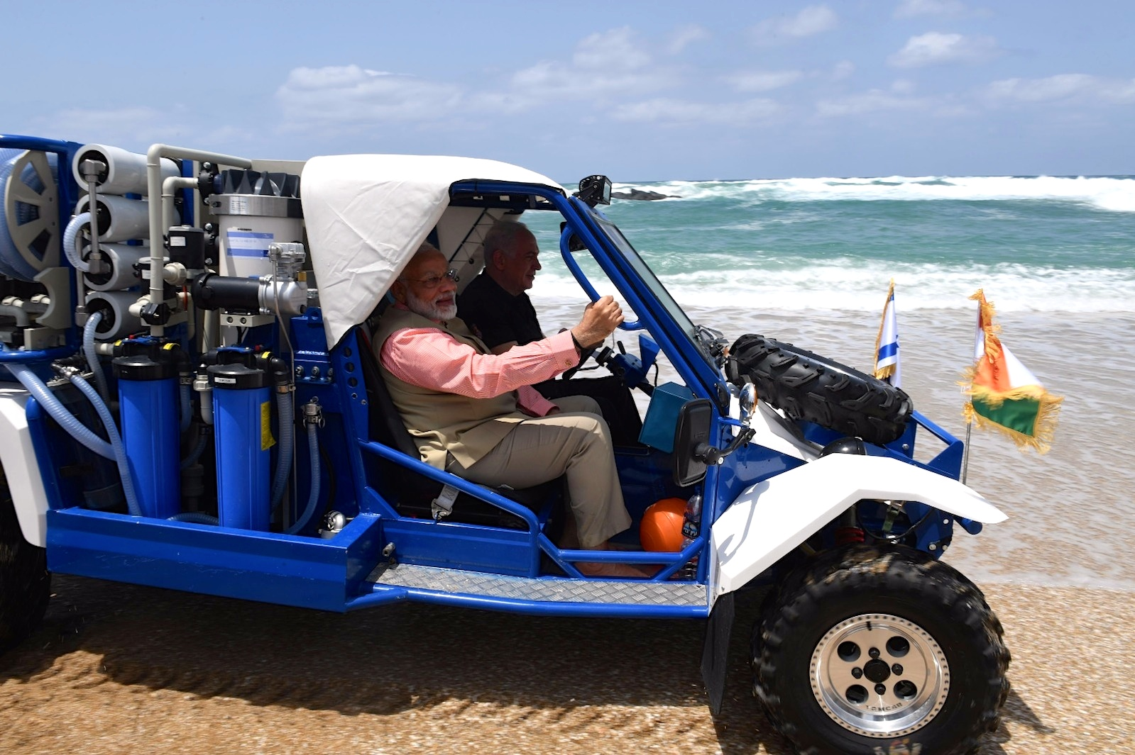 Indian Prime Minister Narendra Modi and Israeli Prime Minister Benjamin Netanyahu take a jeep ride on the Olga Beach in northern Israel Thursday. Credit: Kobi Gideon/GPO.