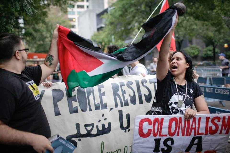 The Palestinian Authority flag is featured at a Jewish Voice for Peace (JVP) protest in New York City last September. Credit: JVP via Facebook.