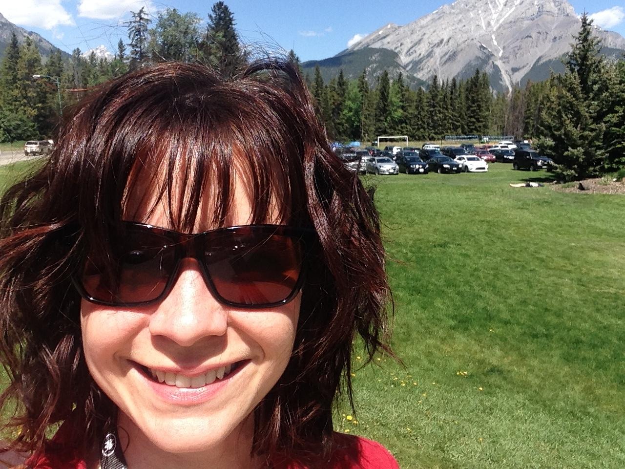 Rachel Berdan standing in front of Rocky Mountains in Banff, Alberta