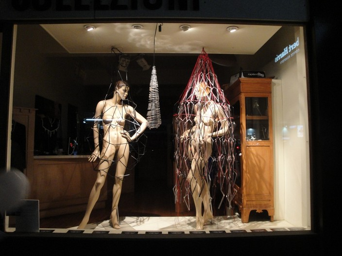 Three sculptures, two mannequins and a pendant.