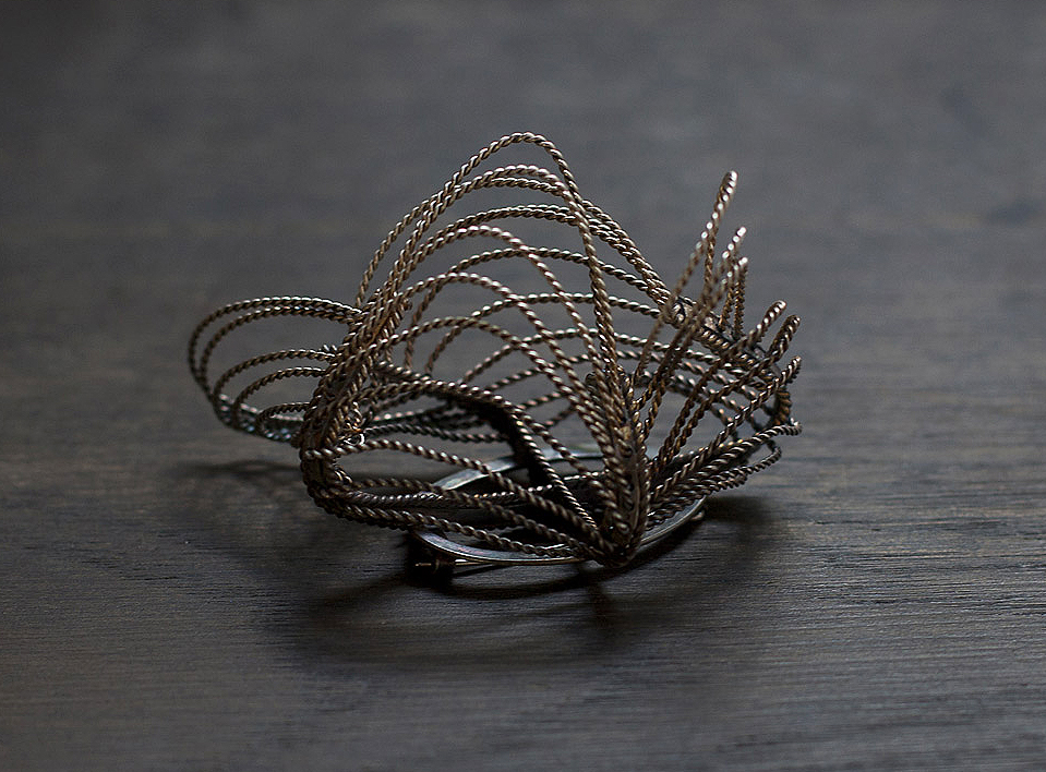 Freeflow Brooch 2012, partially oxidised silver.