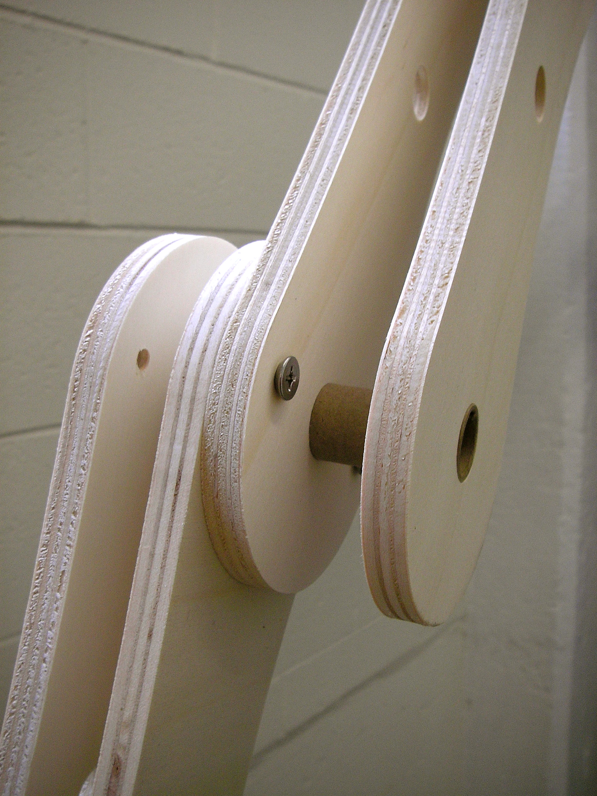 Curved joints are bolted together in graduated size ranges and spaced with a cardboard tube.