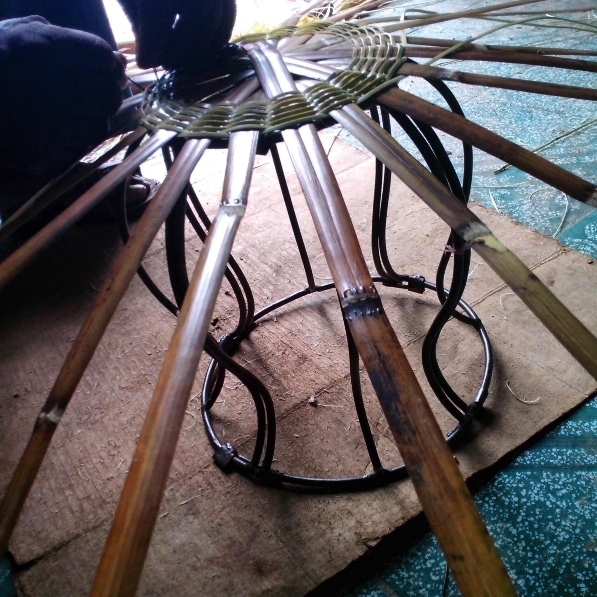 Shaping basket around collapsible iron bracket