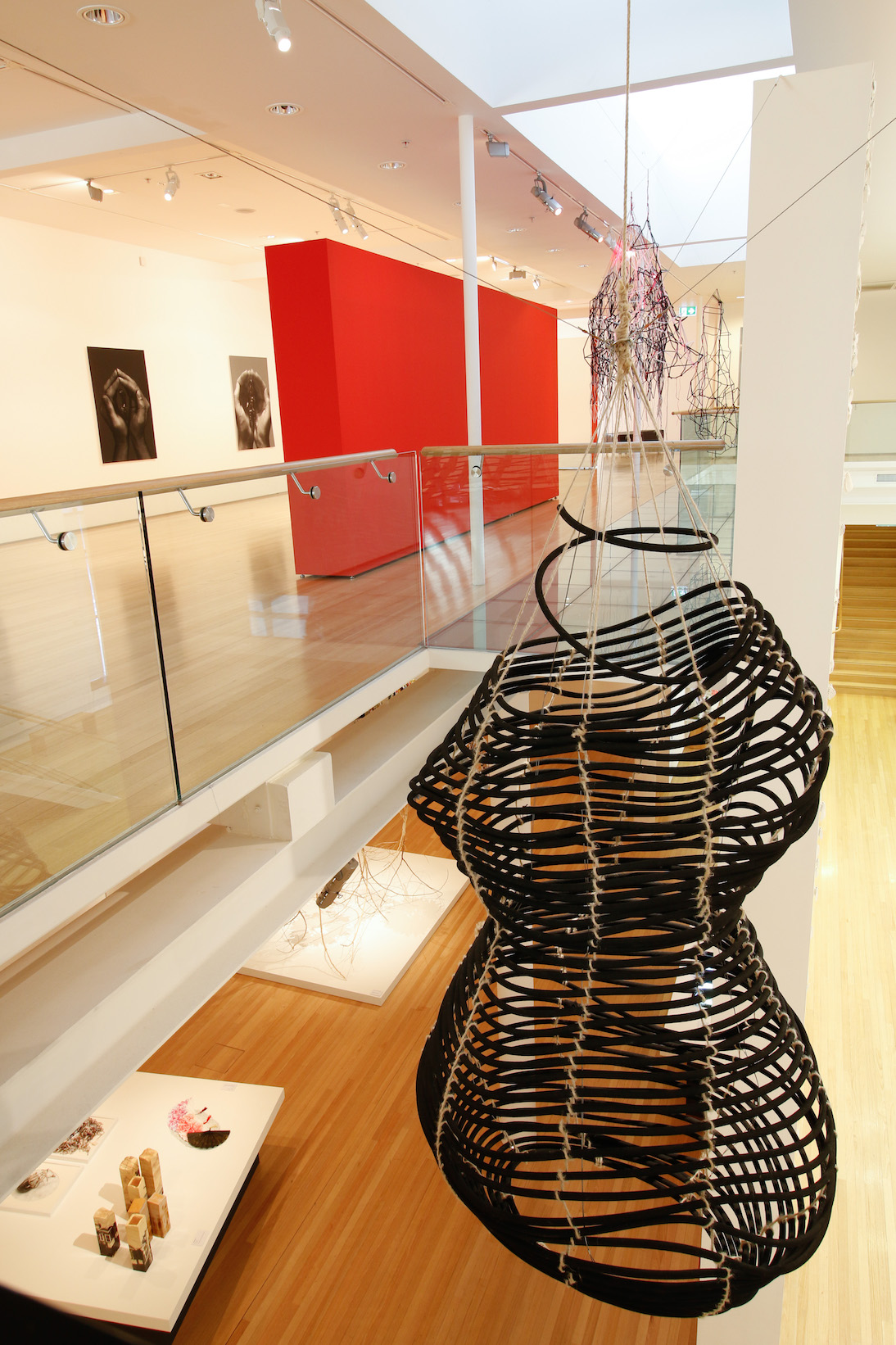 5b No-One, view into hanging sculptures and lower gallery.jpg