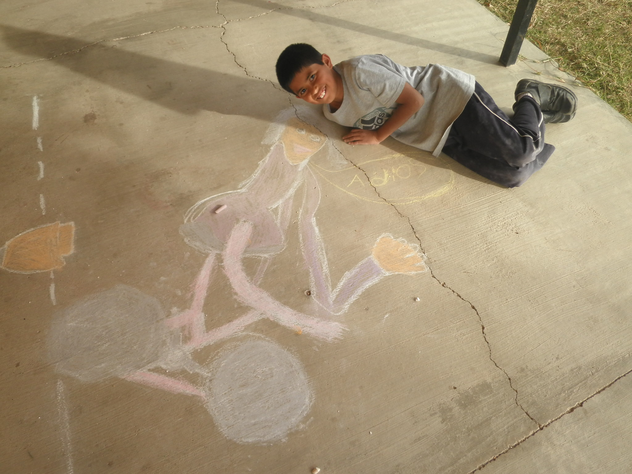 Toño shows off his chalk creation