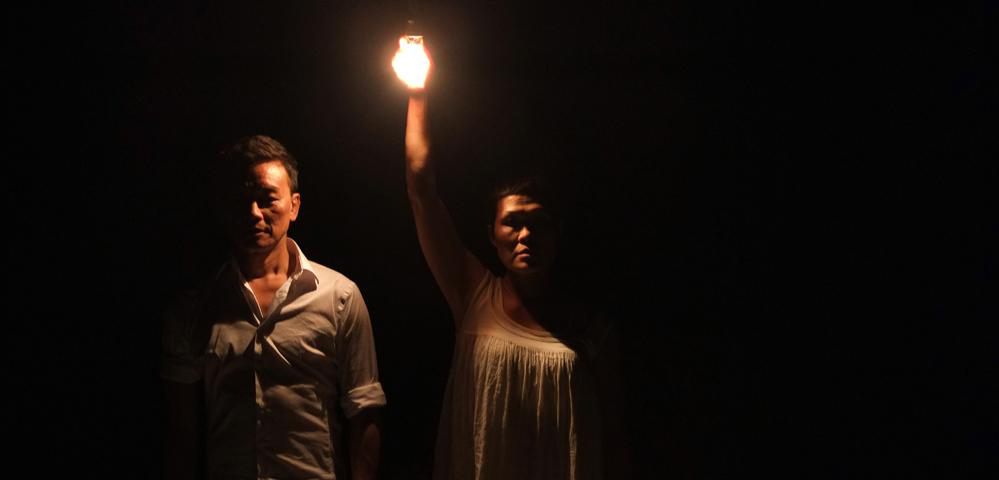 Tony Yap and Yumi Umiumare performing in their work  Zero Zero  (Image source: Dancehouse)