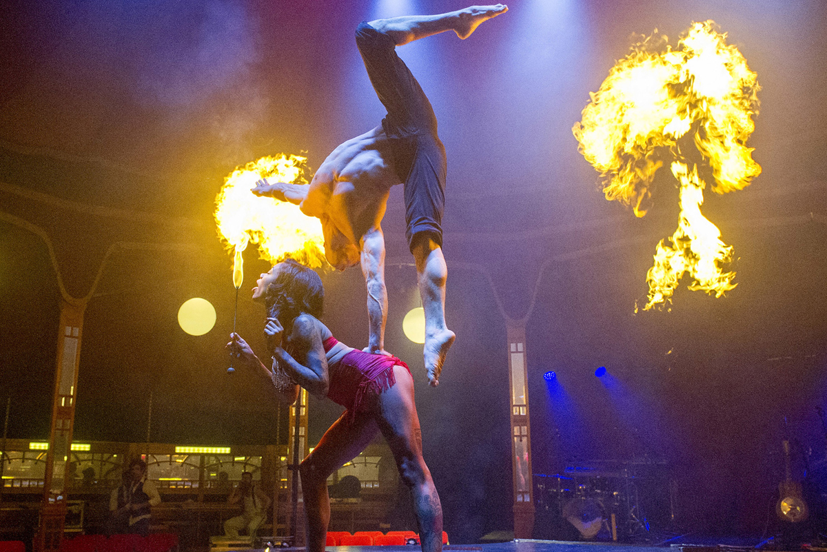 Hand-balancer, Danik Abishev, with fire-breather, Heather Holliday, in  Limbo  (Image credit: Alastair Muir)