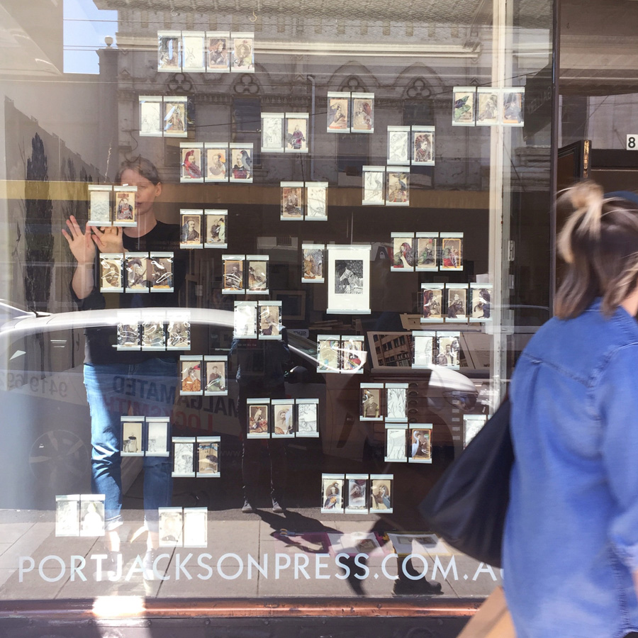 Yesterday, installing our pieces in the window and  catching reflections
