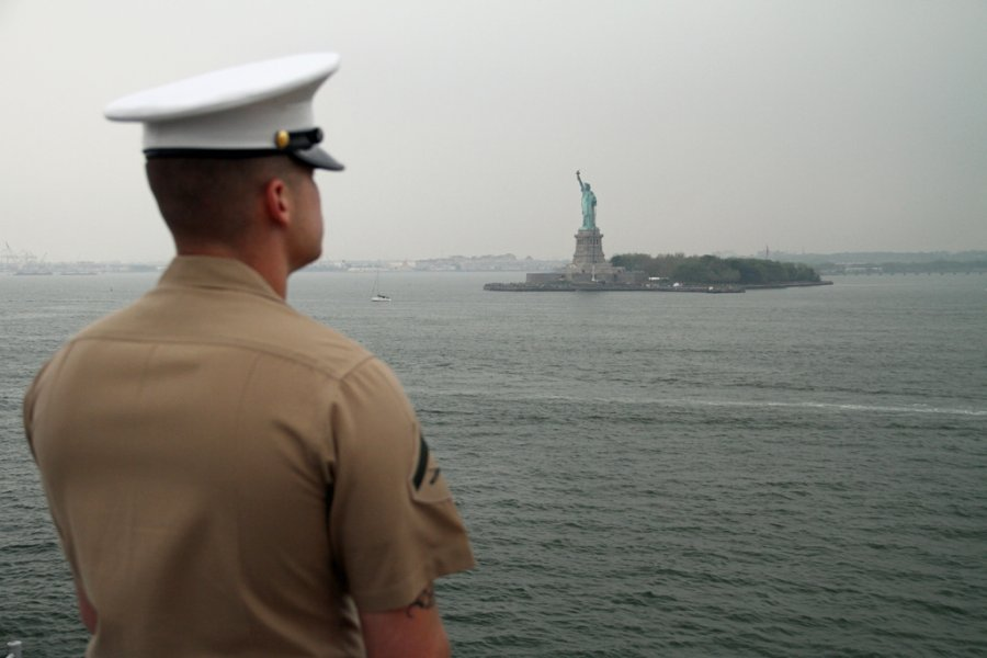 moments-later-the-ship-sailed-past-the-statue-of-liberty-as-this-marine-stood-silently-by-and-watched.jpg