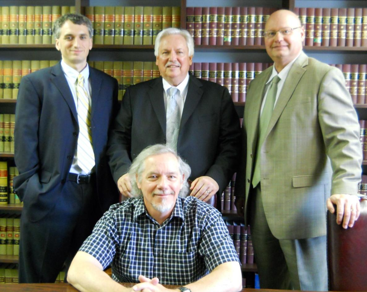 Attorneys Jarrett Pabst, Tom Pabst, & Michael Kowalko with Police Chief Bruce Whitman after the May Decision by the Michigan Supreme Court
