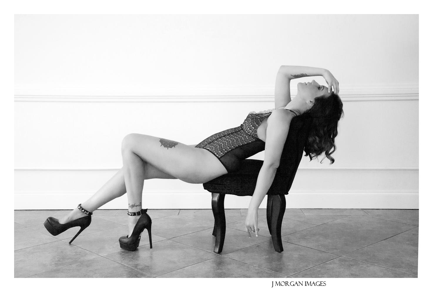 sexy bodysuit black chair