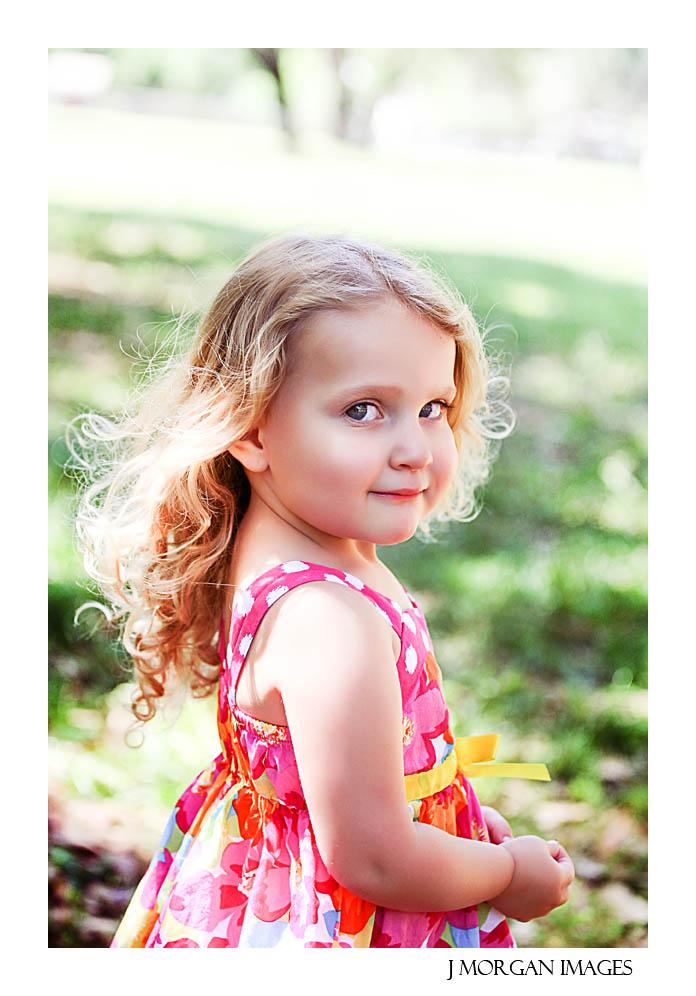 little gi in pink looks over her shoulder