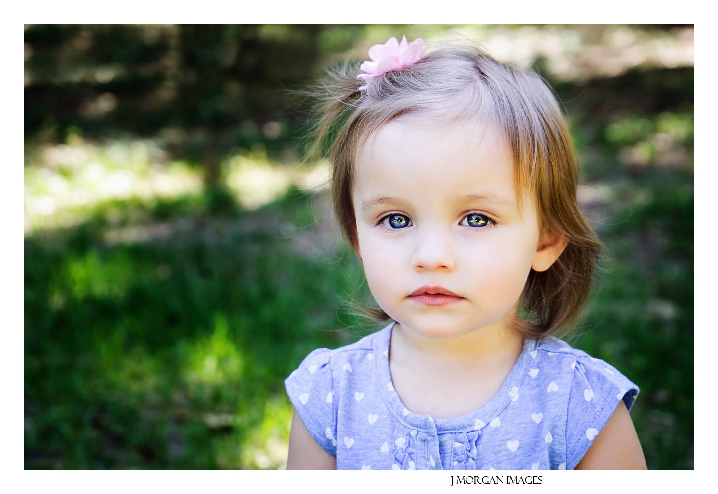 beautiful blue eyed little girl in purple