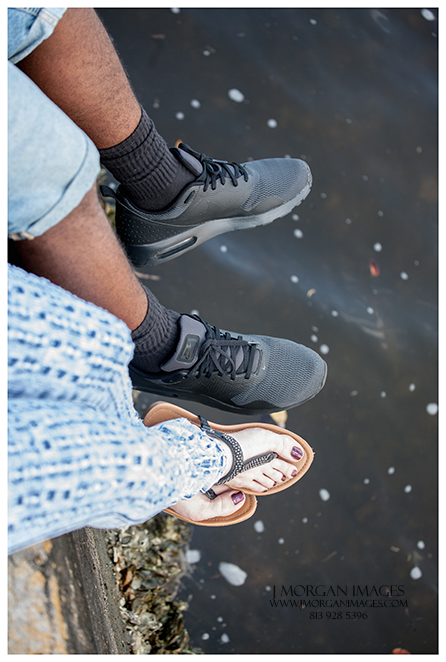 feet on the edge of tampa river