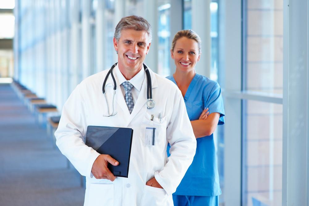 doctor and nurse in windowed hallway.jpg