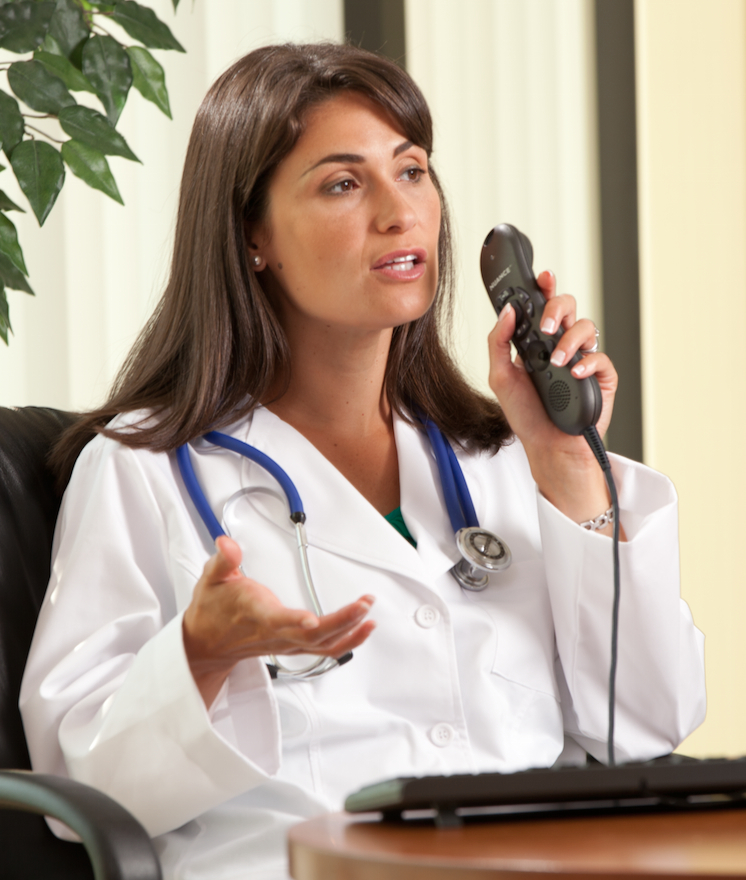 Clinician using Nuance PowerMic II