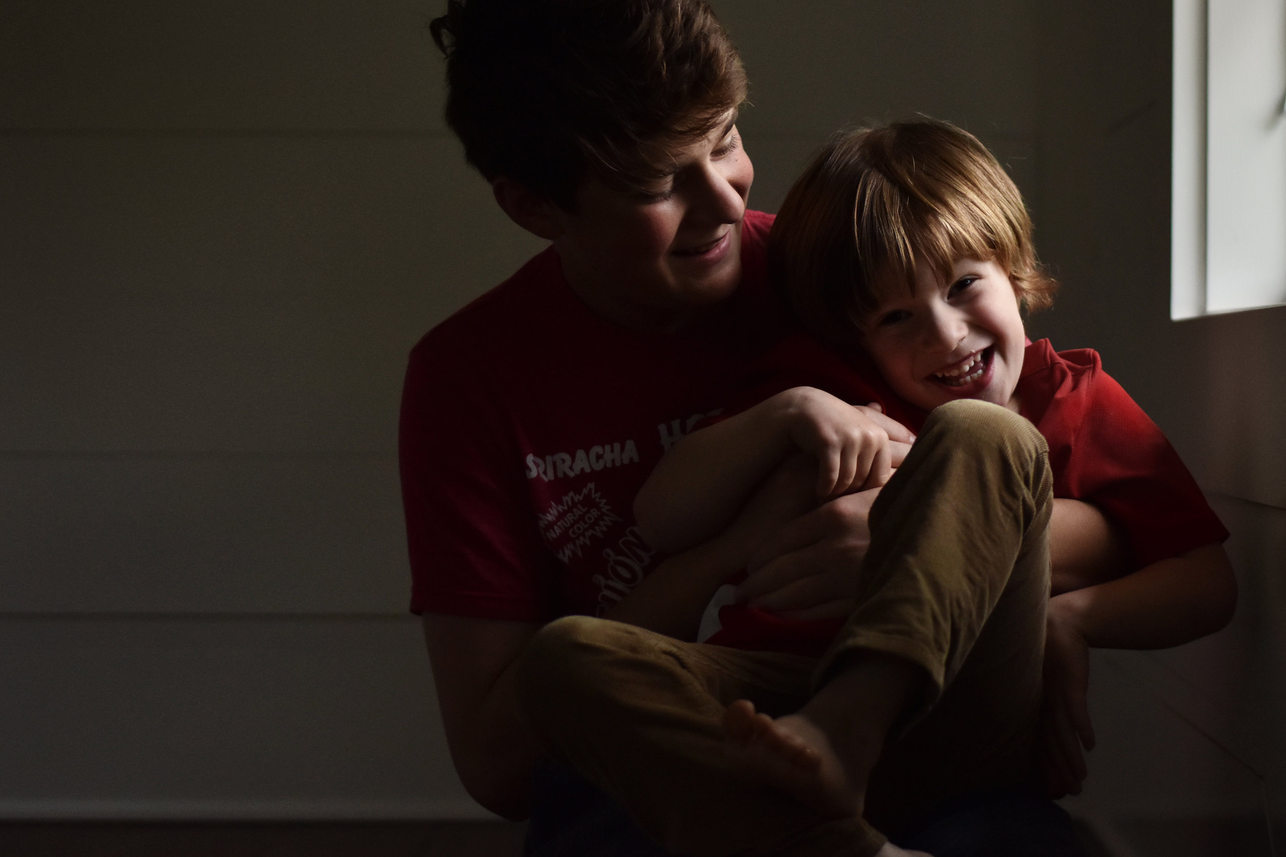 D5600 two boys smiling together by window by kellie bieser.jpg