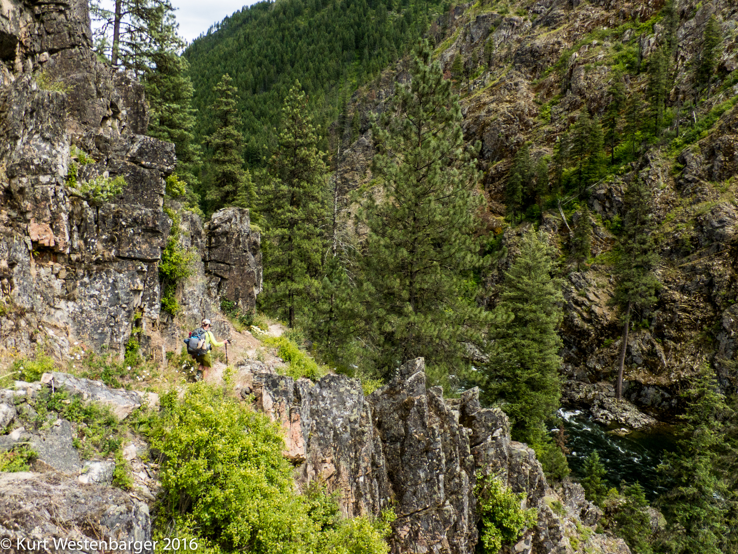 The trail traverses several cliff faces on this route.