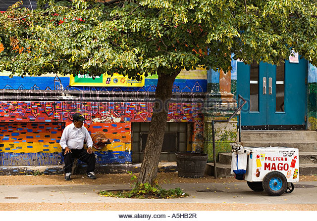 illinois-chicago-mexican-man-sit-in-shade-of-tree-outdoor-mural-popsicle-a5hb2r.jpg