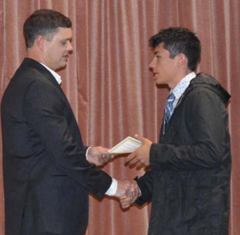 Jonathan Bethel presents the Bethel-Guidry scholarship to Hunter Reaux.