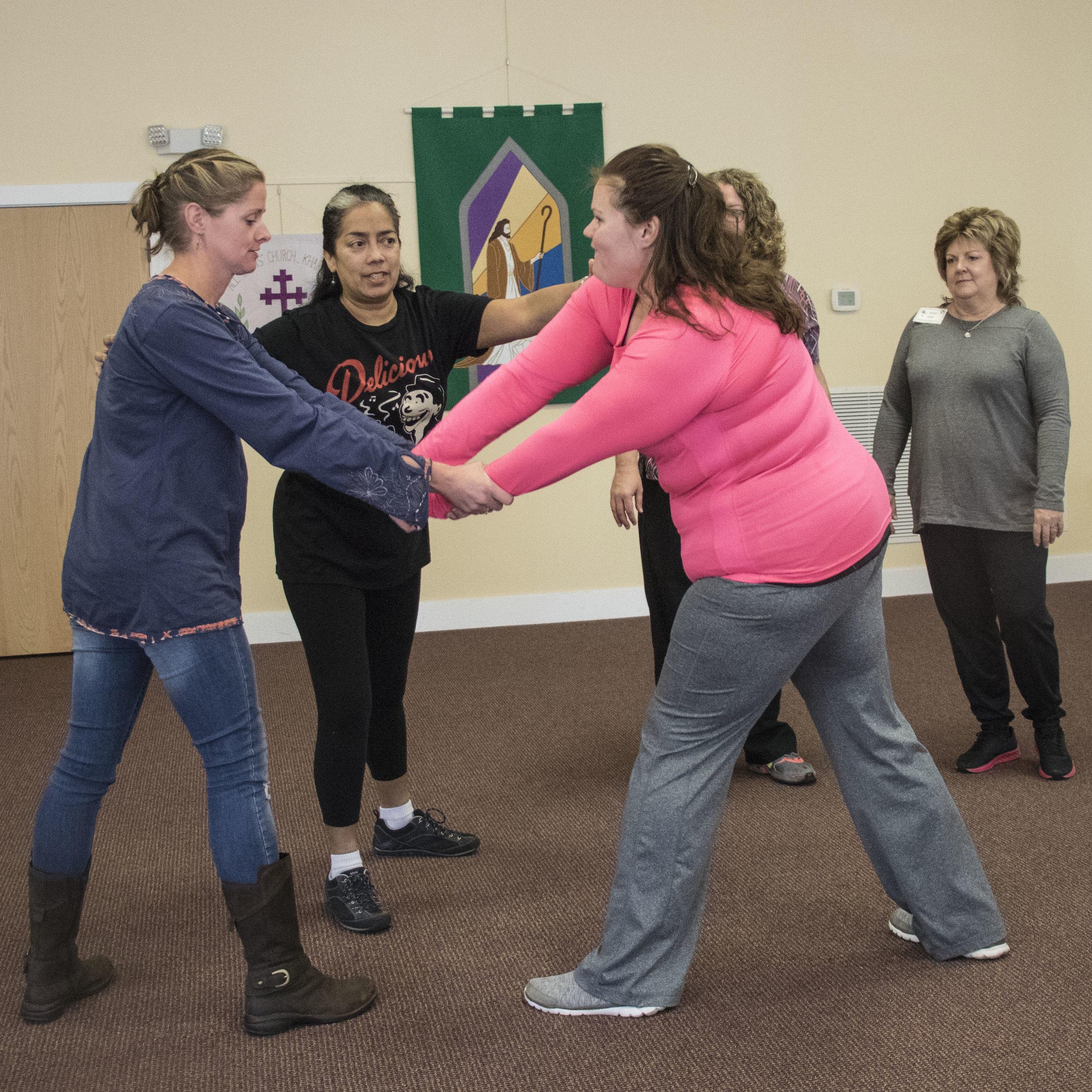Cameron Green, Judith Alvarado, Amanda Guitierrez, Tracey Cothren, Susan Gray in a self defense class.