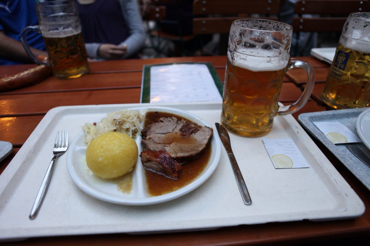 A most amazing dinner of potato dumpling, roast pork, and a huge stein of beer.