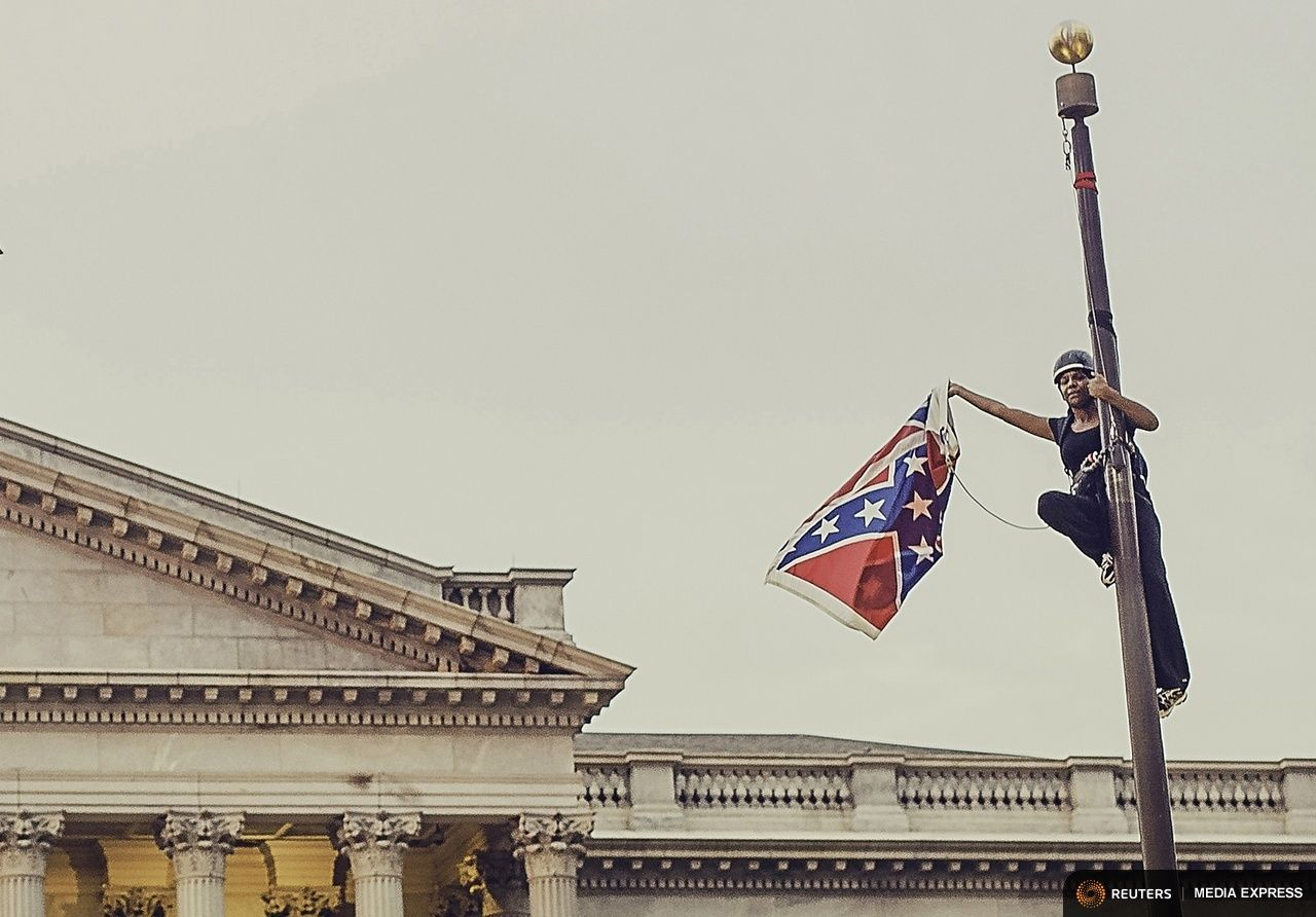 Bree Newsome pulling down the racist Confederate flag.