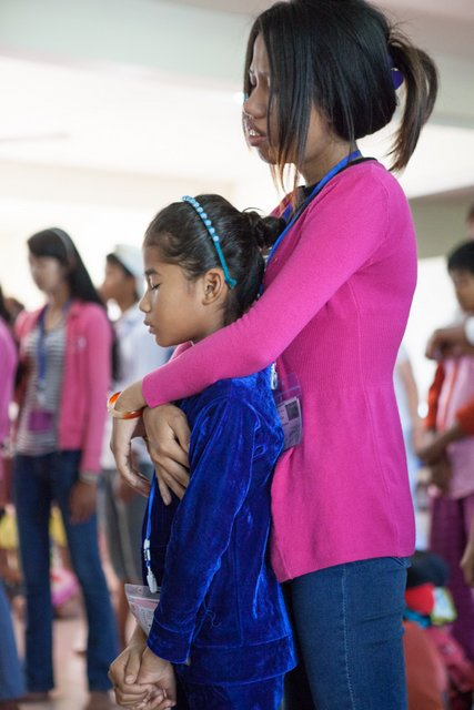 "An Alongsider praying for her ""little sister"" (who is also her neighbor)"