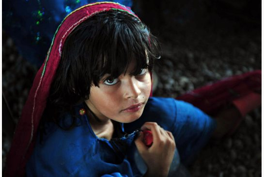 A young Afghan refugee at the UN registration centre in Pakistan, is among more than 43 million displaced persons worldwide. (Image: A. Majeed / AFP)