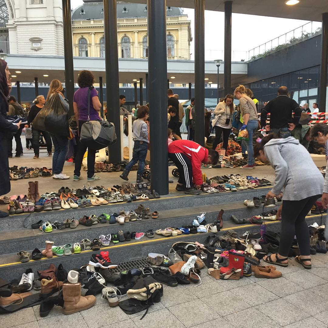 Bless their soles. Hungarians leave shoes for refugees at a Budapest railway station.