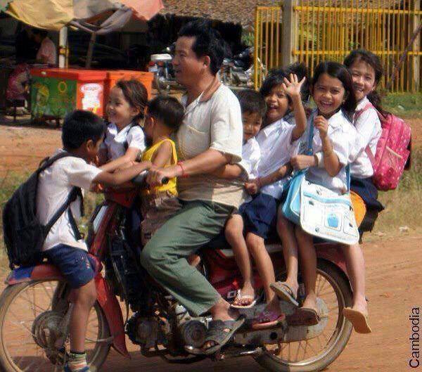 Who needs public transport to get to know your neighbours? This is how we roll in Cambodia. Cozy!