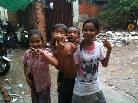 """My neighbors during a rain storm, giving """"the finger"""" to exploitation and violence."""