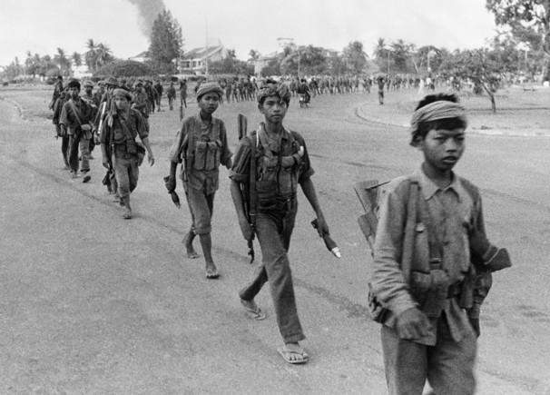Khmer Rouge child soldiers enter Phnom Penh.
