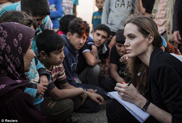 Keep working on that steely, yet deeply concerned, gaze and one day you too can be as cool as Angelina.