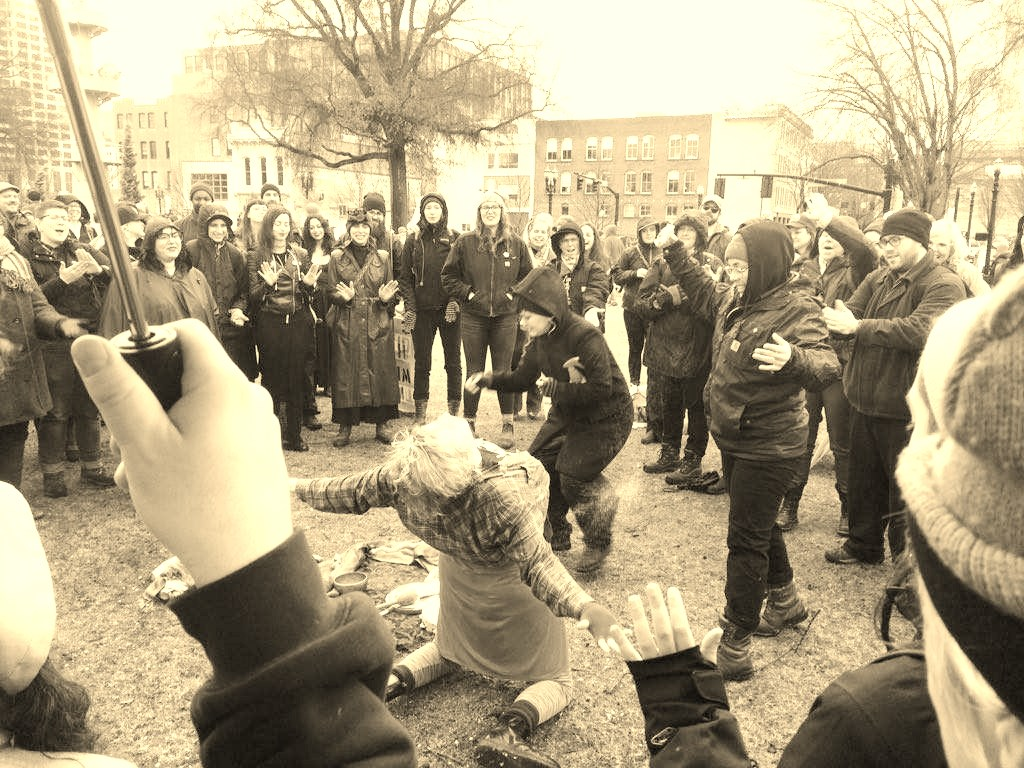 Queer Witches Bash Back:  Rhea and others give/receive an exorcism of the patriarchy at a public ritual on January 21, 2017.