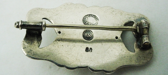 The current Georg Jensen hallmark bears an uncanny resemblance to one of the older hallmarks. One way of differentiating the two is the 830S mark. Continental silver, which only contains 83% silver, was the older standard used before 1927, when the silversmithy switched over to Sterling.