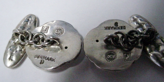 This unusual set of cufflinks contains the 830S mark with the square GJ hallmarks