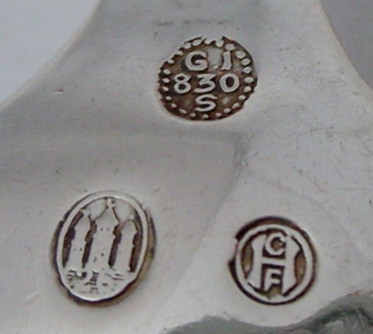 This is an excellent example of the three towers mark, denoting the year of its manufactury (1926) Also present is the GI 830S mark. The CFH stamp is actually a guardian stamp and was used between 1904 and 1932.