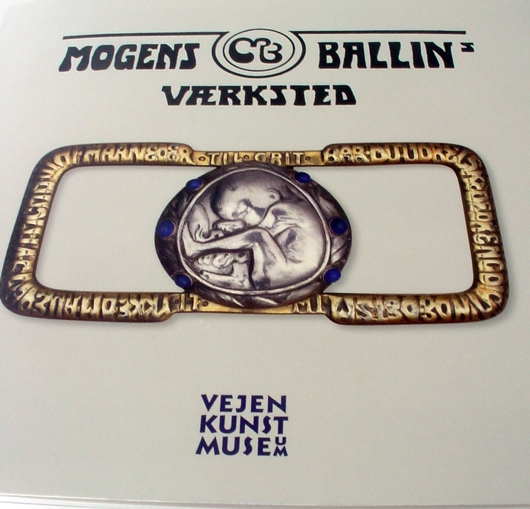 The cover of thehe book on Mogens Ballin released by the Vejen Art Museum featuring the belt buckle created by Mogens Ballin for his wife, Marguerite celebrating his first born.
