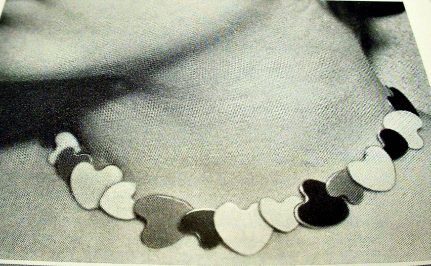 """The 1940's and before were typified by the functionalism that swept a number of the European nations. Decoration had been minimized or nonexistent in the jewelry pieces of this era, and industrialization took center stage and enamelling became prominent.  This """"Heart Necklace"""" designed by Tov and Edvard Kindt -Larsen from 1941 for A. Michelsen , can almost stand as a symbol of the forties feel for that simple, achievable and ordinary things can own great artistic quality and beauty."""