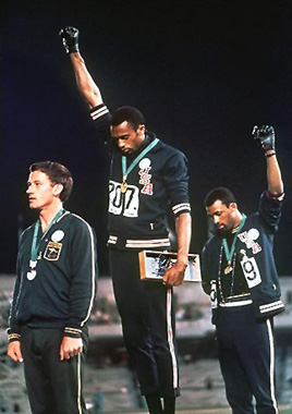 """Watching the doco SALUTE - the story of Peter Norman, the white  Australian who won the silver for the 200m at the Mexico Olympics... it's a story about Tommy Smith & John Carlos making one of the most memorable statements of the decade I was born in!    The protest    On the morning of October 16, 1968,   [ 2 ]    U.S. athlete Tommie Smith won the  200meter race  in a world-record time of 19.83seconds, with  Australia's   Peter Norman  second with a time of 20.07seconds, and the U.S.'s John Carlos in  third place with a time of 20.10seconds. After the race was completed,  the three went to collect their medals at the podium. The two U.S.  athletes received their medals shoeless, but wearing black socks, to  represent black poverty.   [ 3 ]    Smith wore a black scarf around his neck to represent black pride,  Carlos had his tracksuit top unzipped to show solidarity with all blue  collar workers in the U.S. and wore a necklace of beads which he  described """"were for those individuals that were lynched, or killed and  that no-one said a prayer for, that were hung and tarred. It was for  those thrown off the side of the boats in the  middle passage .""""   [ 4 ]    All three athletes wore  Olympic Project for Human Rights  (OPHR) badges after Norman, a critic of Australia's  White Australia Policy , expressed empathy with their ideals.   [ 5 ]    Sociologist  Harry Edwards ,  the founder of the OPHR, had urged black athletes to boycott the games;  reportedly, the actions of Smith and Carlos on October 16, 1968   [ 2 ]    were inspired by Edwards' arguments.   [ 6 ]      Both U.S. athletes intended on bringing black gloves to the event,  but Carlos forgot his, leaving them in the Olympic Village. It was the  Australian, Peter Norman, who suggested Carlos wear Smith's left-handed  glove, this being the reason behind him raising his left hand, as  opposed to his right, differing from the traditional Black Power salute.   [ 7 ]    When """" The Star-Spangled Banner """"  played, Sm"""