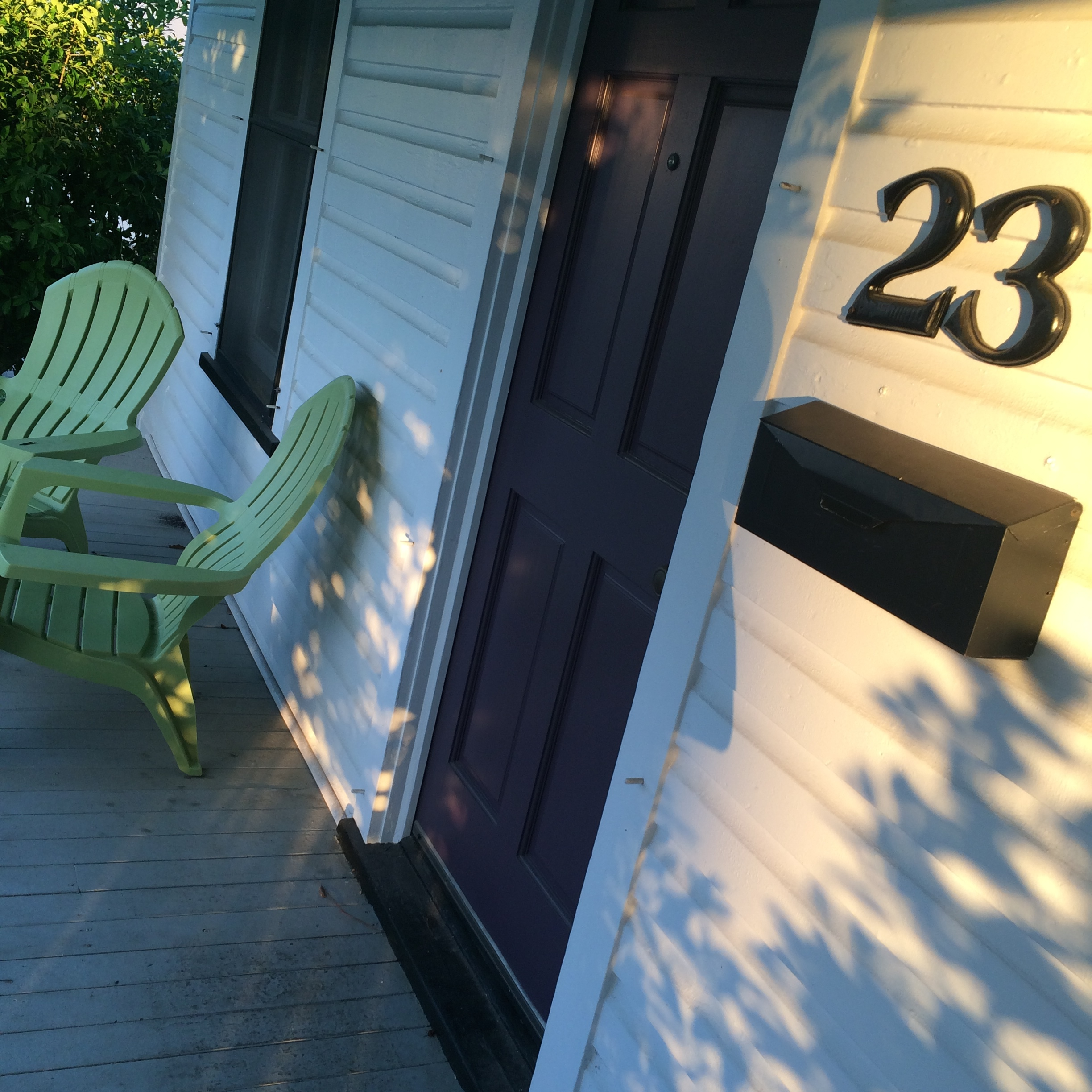 my purple door and green chairs and sunlight