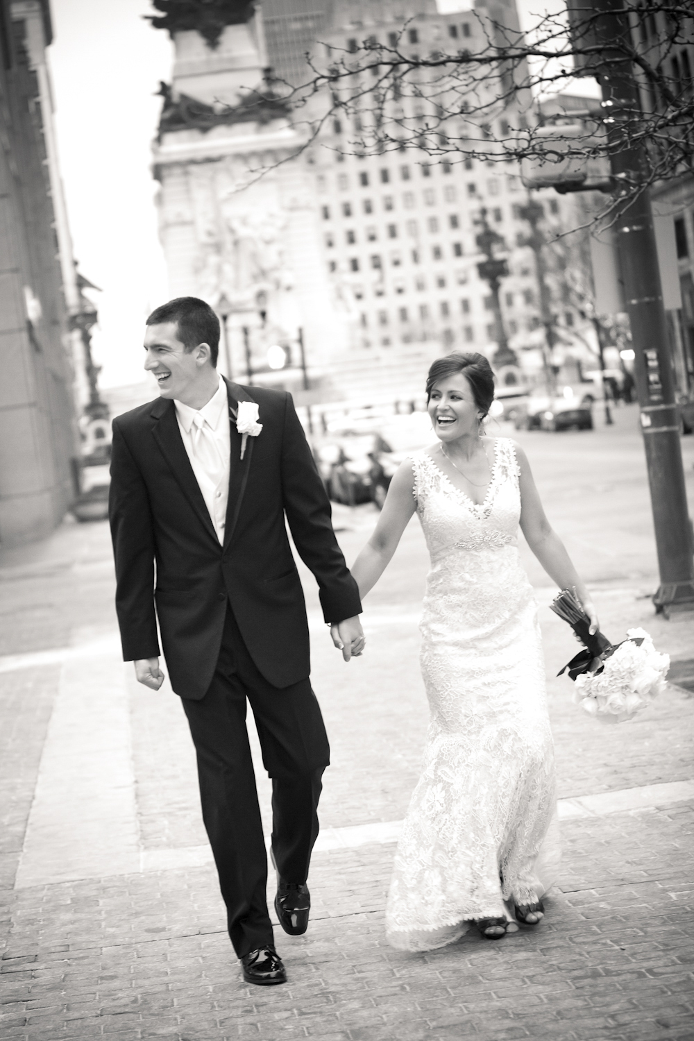 Indianapolis-Indiana-Wedding-Photographer-Crowes-Eye-Photography-Monument-Circle-laughter-Bride-and-Groom.jpg