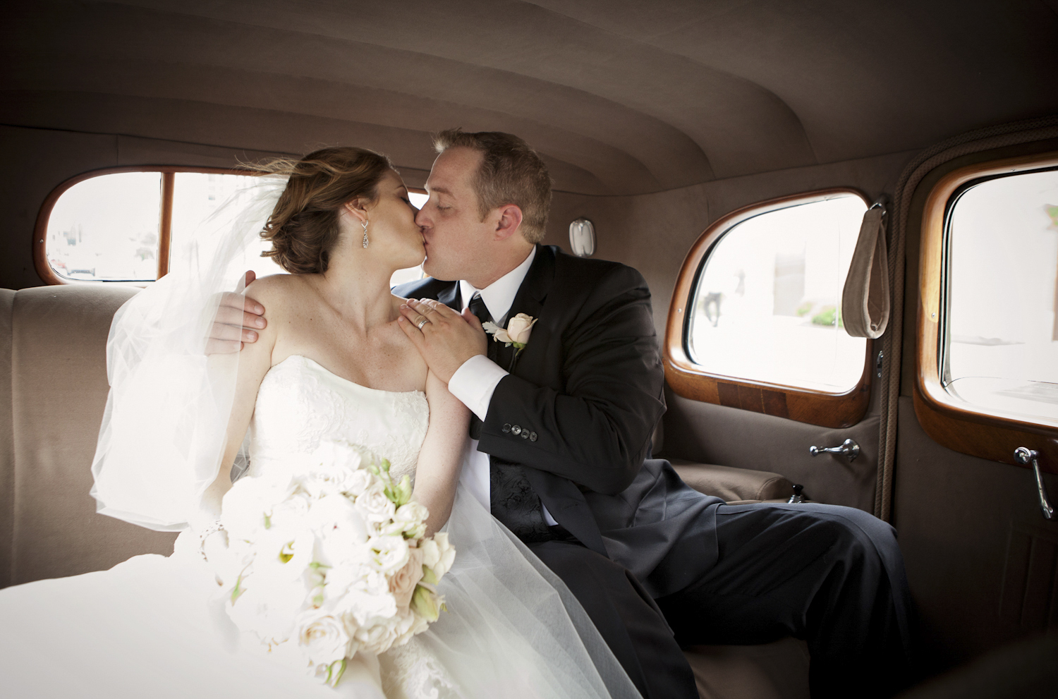 Indianapolis-Indiana-Wedding-Photographer-Crowes-Eye-Photography-Get-away-Kiss.jpg